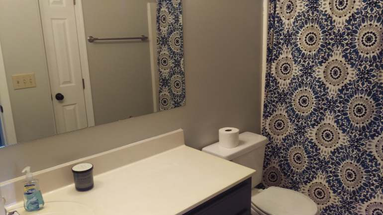 Bathroom with modern blue and gray shower curtain