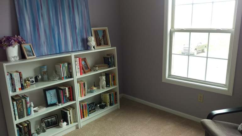 Office with two bookshelves with books and knick knacks